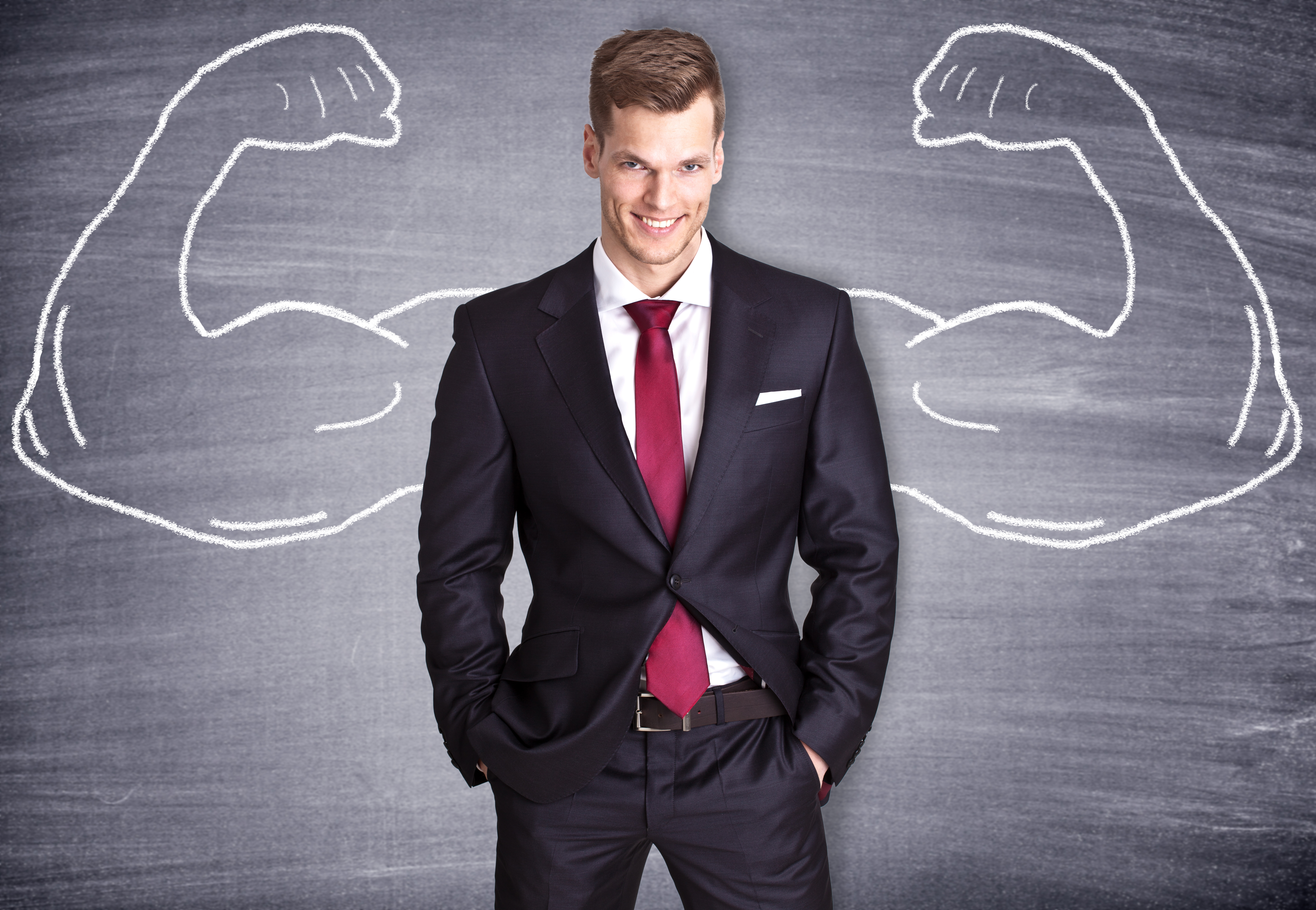 Image of business man with strong chalk arms drawn - demonstrate how to be confident and be successful in business