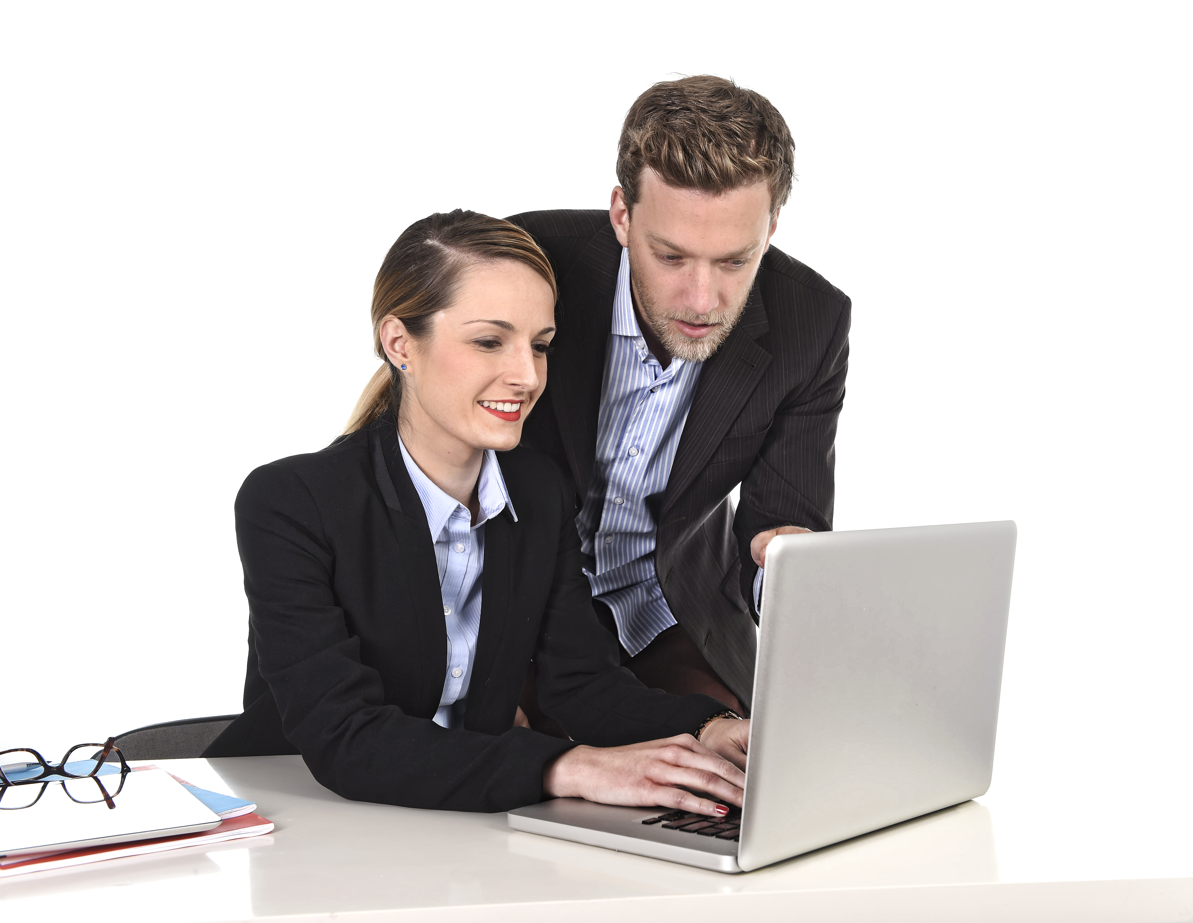 Image of a business woman showing something to a colleague on a computer - Represents that Your town planner can teach you the basics about development approval