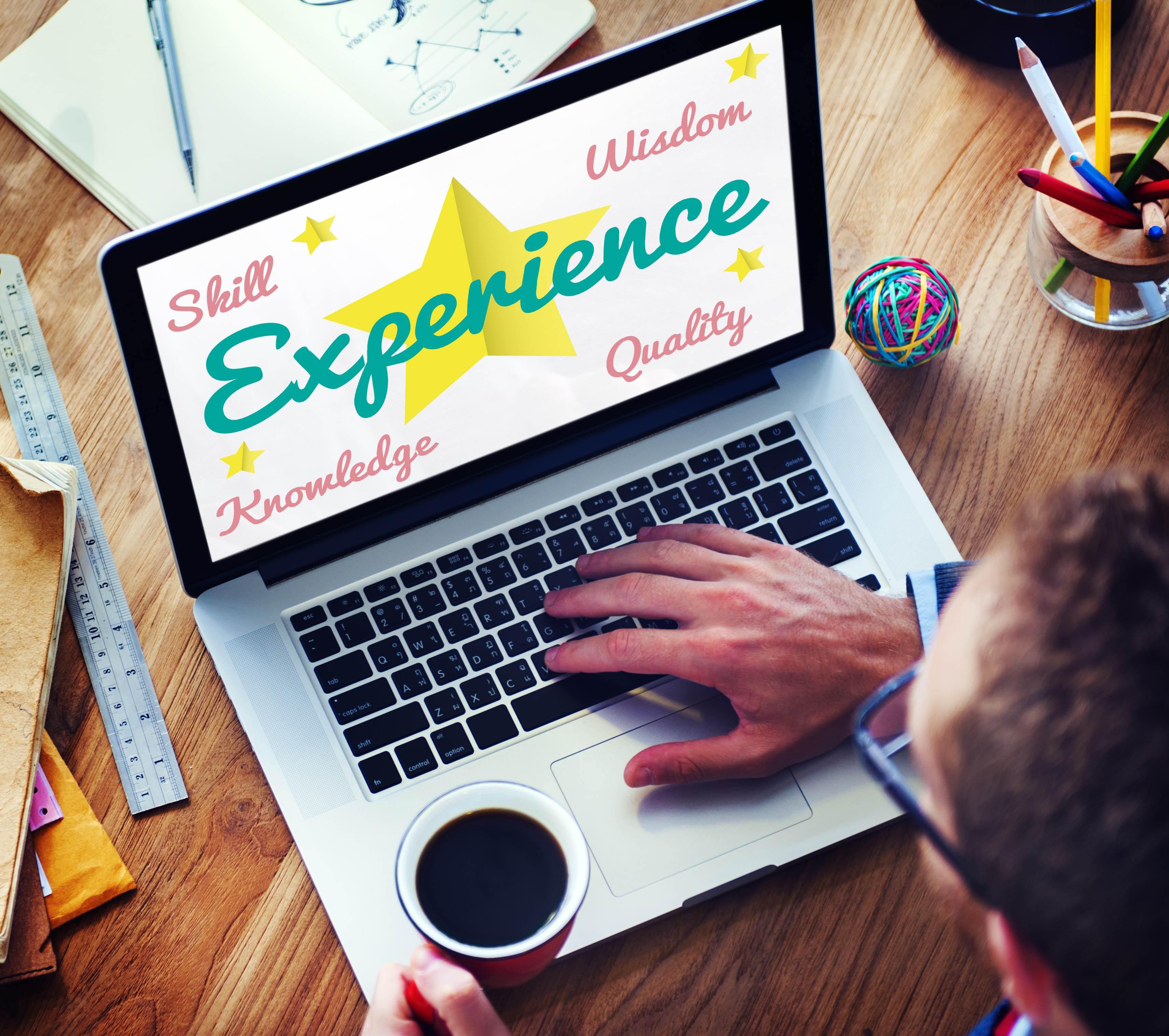 Picture of someone looking a computer screen with the word Experience written on it. Shows that A Property Investing Secrets is to use yout personal experience to your advantage