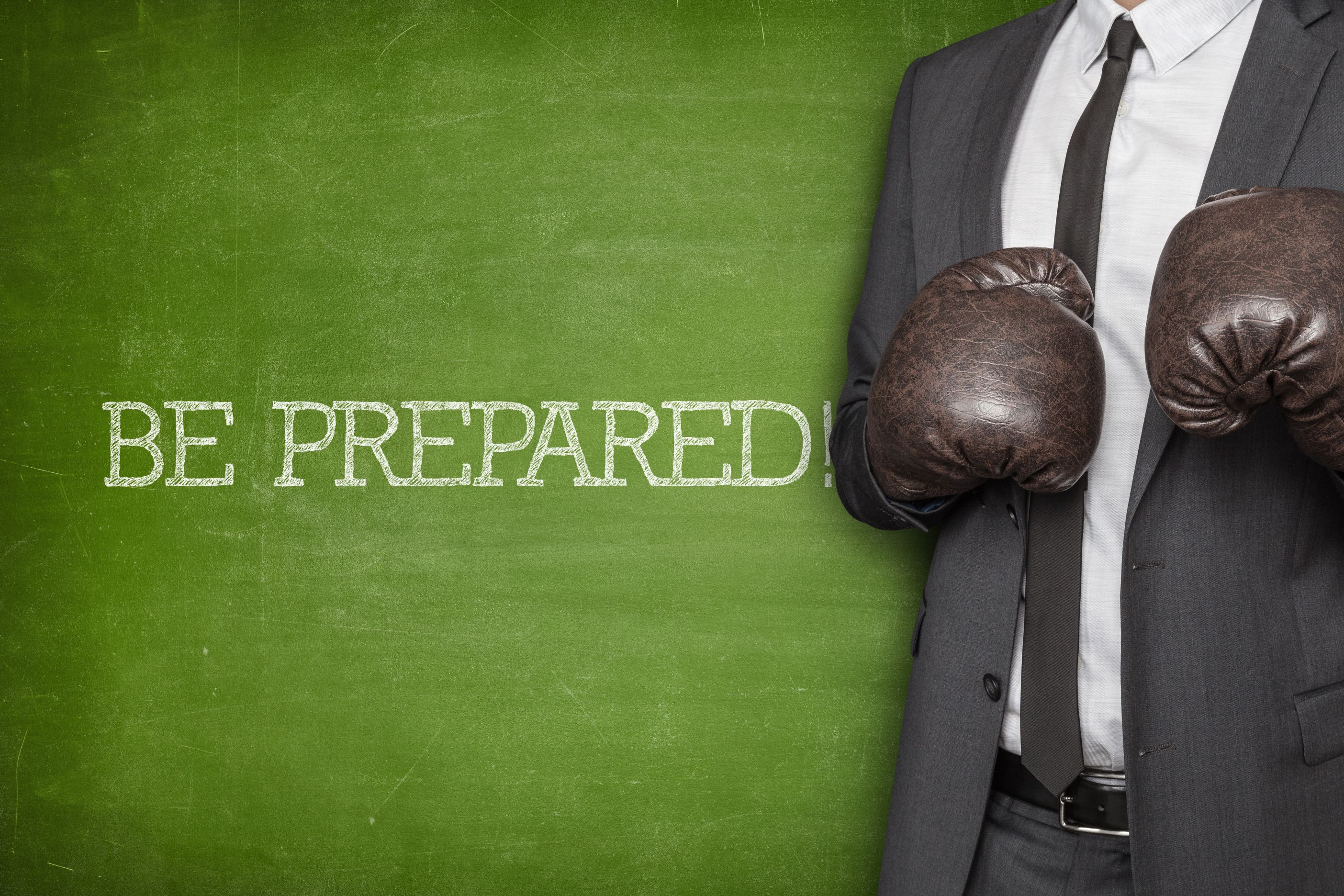 Picture of a business man wearing boxing gloves. Property Investing Secret Be prepared to anything