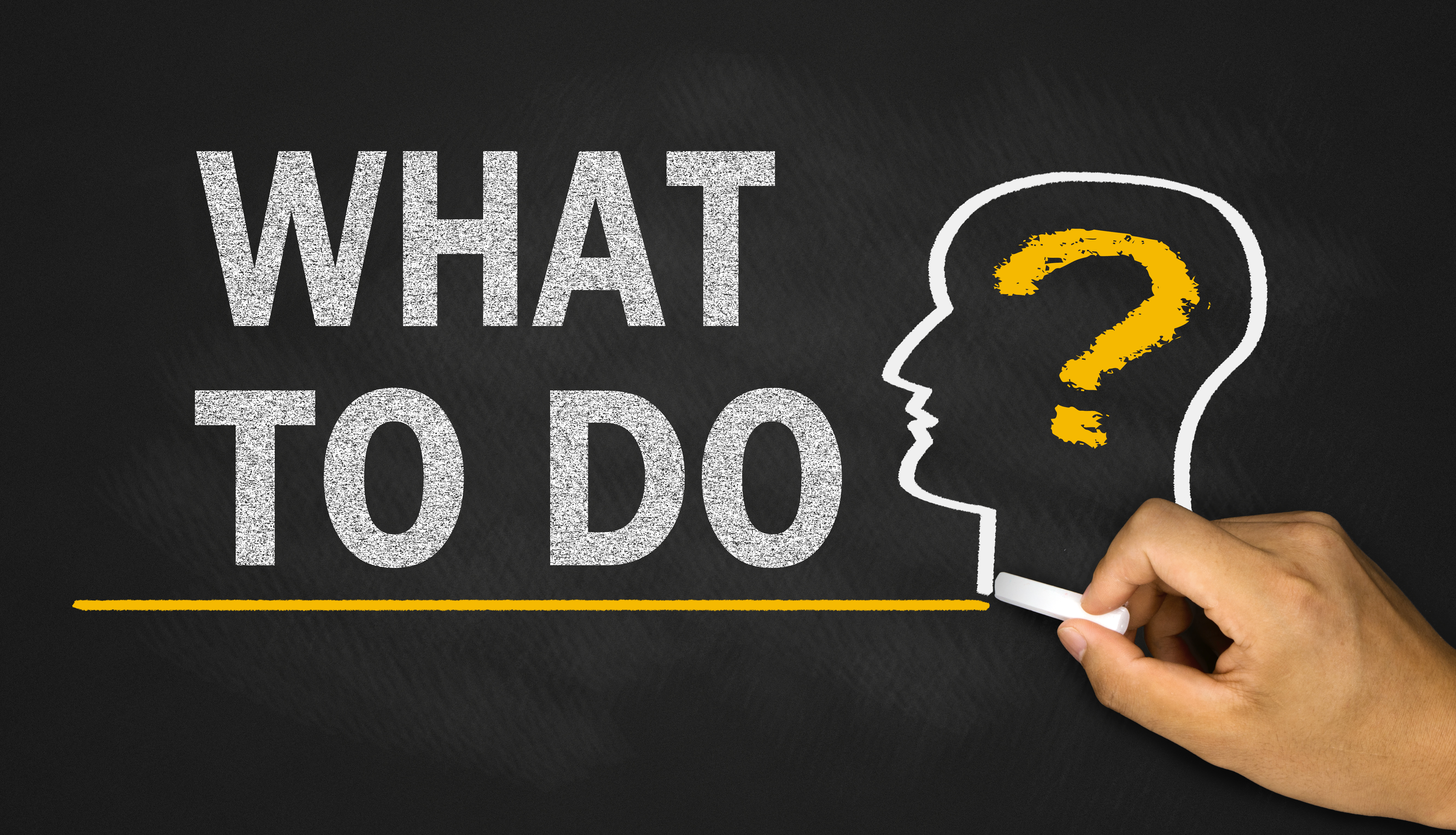 """drawing of the question """"what to do"""" written in a black board - What to do when you know what is the Right Property Investing Strategy For You"""
